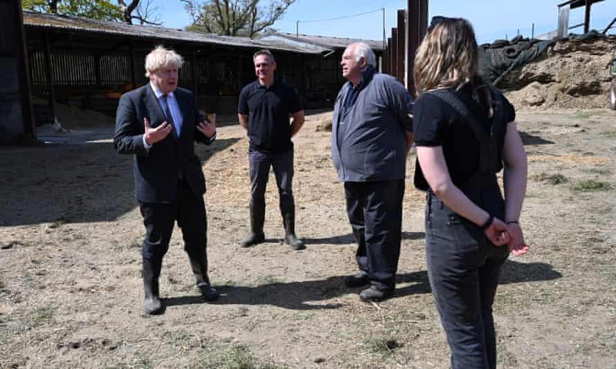Boris Johnson visits Moreton farm near Wrexham, north Wales, in April.