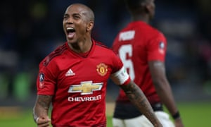 Ashley Young celebrates Manchester United's win at Chelsea. He said the team had hoped to draw Manchester City in the next round.
