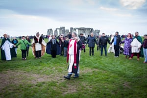 People gather at Stonehenge in Wiltshire to celebrate the autumn equinox