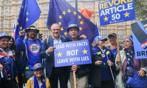 Ed Davey posing with Steve Bray and other pro-remain protesters in September 2019.