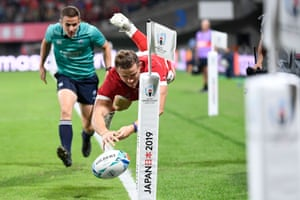 Wales' wing Hallam Amos drops the ball as he drives over.