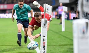 Wales' wing Hallam Amos knocks on the ball as he dives for a try.