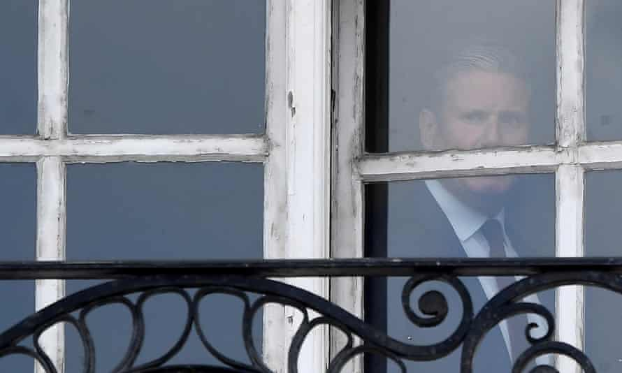 Keir Starmer at the window of his London offices
