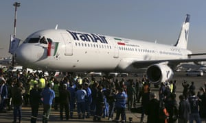The pilot of IranAir's new Airbus plane waves a national flag