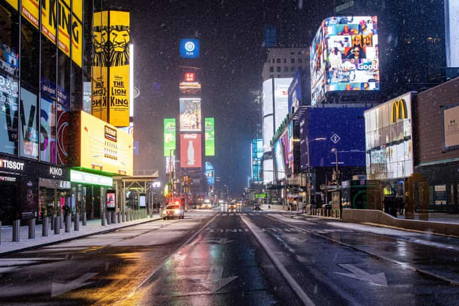 An empty street is seen as snow begins to fall in Times Square during a snow storm, during the coronavirus disease in January 2021.