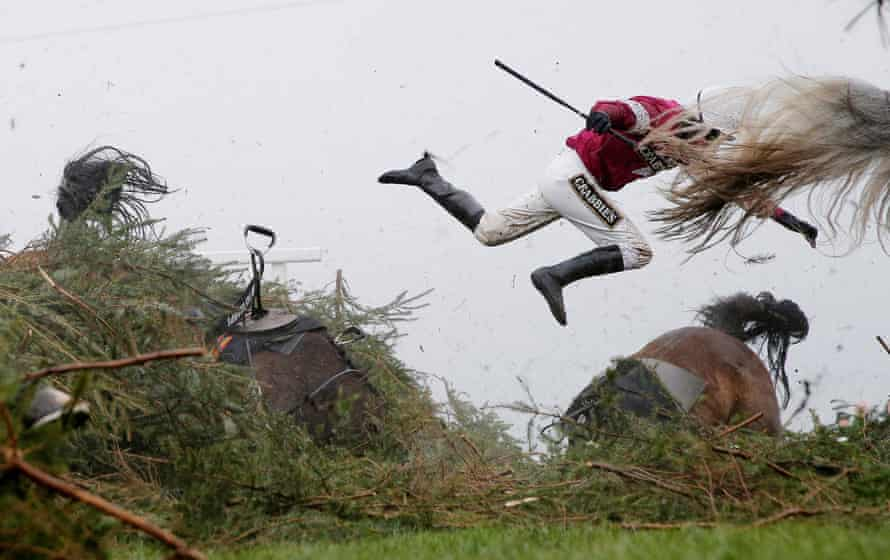 Jockey Nina Carberry flies off her horse Sir Des Champs at The Chair during the Grand National.