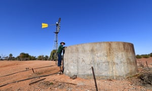 Pastoralist Lachlan Gall checks the water tank on his property at Langawirra Station north of Broken Hill in western New South Wales.