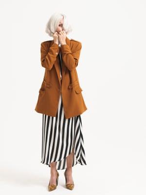 Model wears black white striped dress, £39.99, reserved.com. brown blazer, £179.95, gestuz.com. brown black animal print heels, £243, aeyde.com.