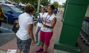 A Florida campaigner registers Latino voters for the presidential election. Activists are now grappling with Trump's stunning win after the Latino vote failed to swing things for Clinton.
