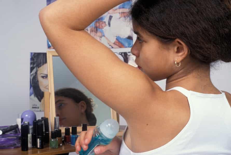 Girl applying deodorant