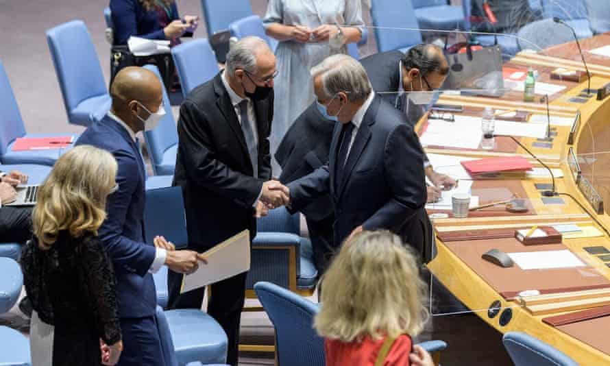 Ghulam Isaczai, left, Afghanistan's permanent representative to the UN, shakes hands with the secretary general, António Guterres, at the start of a UN security souncil meeting on the situation in Afghanistan.