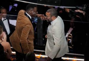 Best Original Screenplay winner Jordan Peele celebrates with Get Out star Daniel Kaluuya