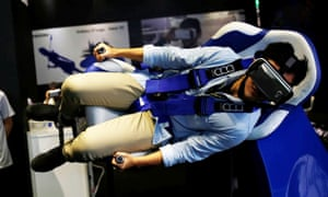 A visitor tries Samsung Gear VR virtual reality headsets during annual Computex computer exhibition in Taipei, Taiwan.