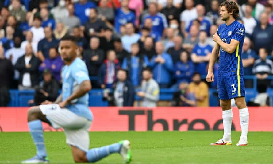 Marcos Alonso points to the say no to racism badge on his shirt, having decided to stop taking the knee