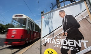 A tramway passes by an election poster reading 'A president who unites' of Alexander Van der Bellen, supported by the Green Party, a day after the Austrian presidential elections run-off in Vienna, Austria.