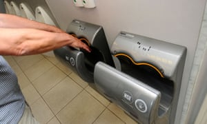 Dyson Airblade hand dryers in a public toilet