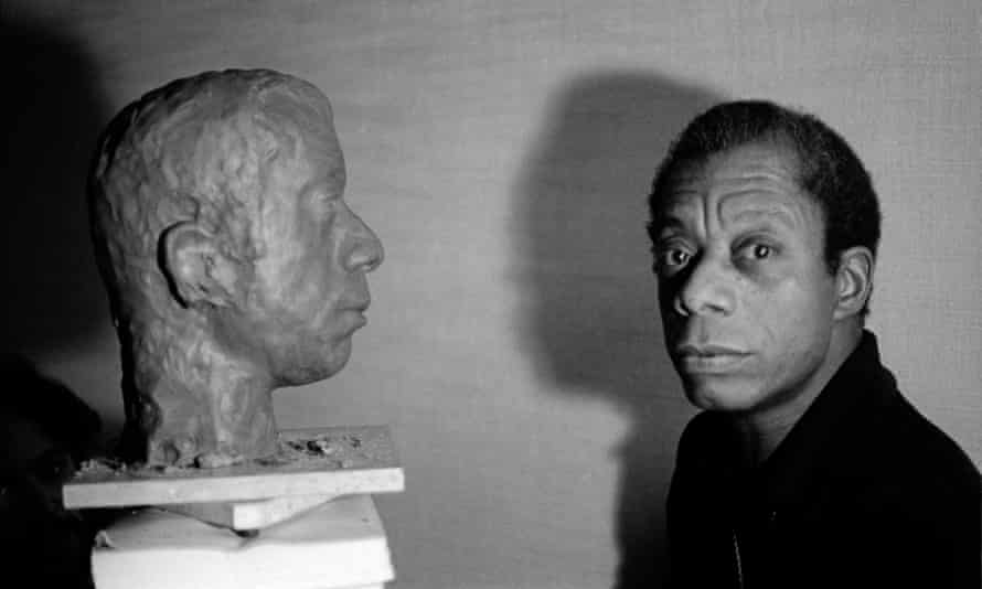 Jane Evelyn Atwood's photograph of James Baldwin with the bust of his head by Lawrence Wolhandler in Paris, 1975.
