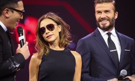 Victoria and David Beckham take part in the Alibaba event in Shenzhen, Guangdong.