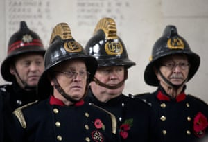 Members of the London Fire Brigade stand under the Menin Gate during an Armistice Day ceremony