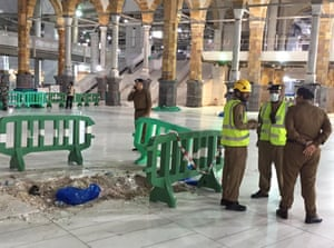 Officials inspect the damage at the Grand Mosque in Mecca after a crane collapsed killing dozens.
