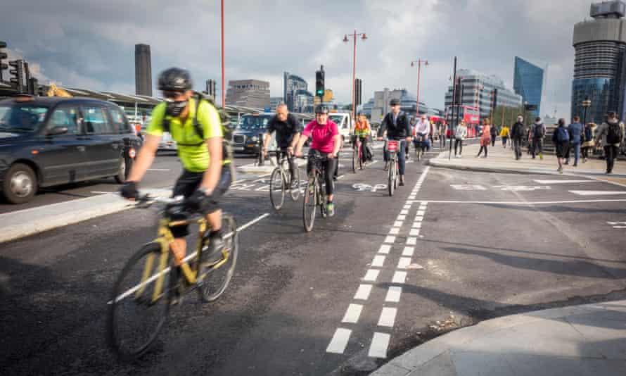 Cyclists using the cycle superhighway on Blackfriars Bridge