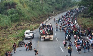 "MEXICO-HONDURAS-US-MIGRATIONHonduran migrants taking part in a caravan heading to the US, walk alongside the road in Huixtla, Chiapas state, Mexico, on October 24, 2018. - Thousands of mainly Honduran migrants heading to the United States, a caravan President Donald Trump has called an ""assault on our country"", continued their march to the US after one-day rest in Huixtla, Chiapas state in Mexico. (Photo by Johan ORDONEZ / AFP)JOHAN ORDONEZ/AFP/Getty Images"