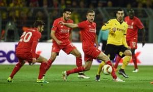 Liverpool's Jordan Henderson, right, Emre Can and Adam Lallana, left, close down Borussia Dortmund's Henrikh Mkhitaryan.
