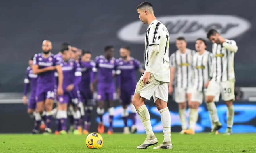 Cristiano Ronaldo looks down after Alex Sandro's own goal left 10-man Juventus facing an uphill struggle against Fiorentina.