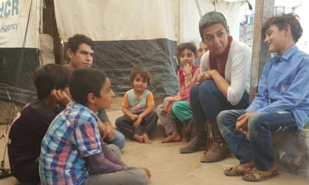 Zainab Salbi talking to children at a refugee camp in Iraq.