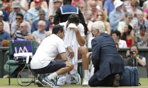 Marin Cilic breaks down while being treated for his injury on Centre Court