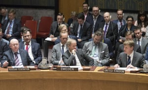 Swedish Ambassador to the United Nations Olof Skoog sits between Russian Ambassador Vassily Nebenzia, and British Deputy Ambassador Jonathan Allen who spoke during a Security Council meeting on the situation between Britain and Russia