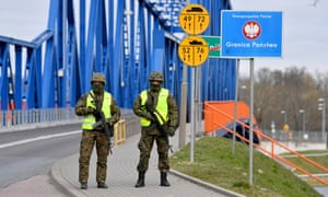 Police and border guard officers secure the borders with Germany in Krajnik Dolny, Poland, 01 April 2020.