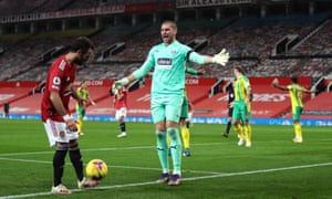 West Bromwich Albion goalkeeper Sam Johnstone (centre) reacts after saving Manchester United's Bruno Fernandes' penalty before it is ordered to be retaken.