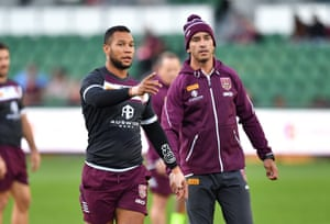 Moses Mbye (left) and former Queensland player Johnathan Thurston (right) are seen during Queensland State of Origin team training at HBF Park in Perth.