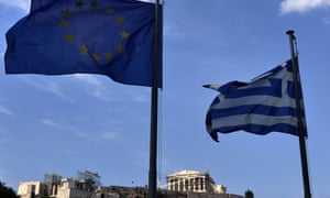 The EU and Greek flags fly together in front of the Acropolis in central Athens.