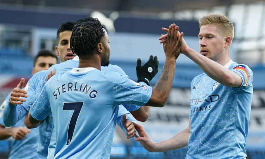 Raheem Sterling is congratulated by Kevin De Bruyne after putting Manchester City 1-0 up against Fulham