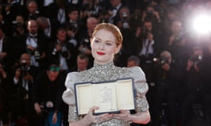 Emily Beecham with the best actress award.