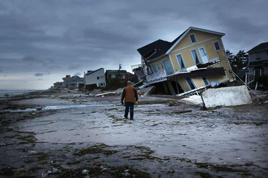 Damage is viewed in the Rockaway neighborhood of Queens, where the historic boardwalk was washed away during Hurricane Sandy on 31 October 2012.