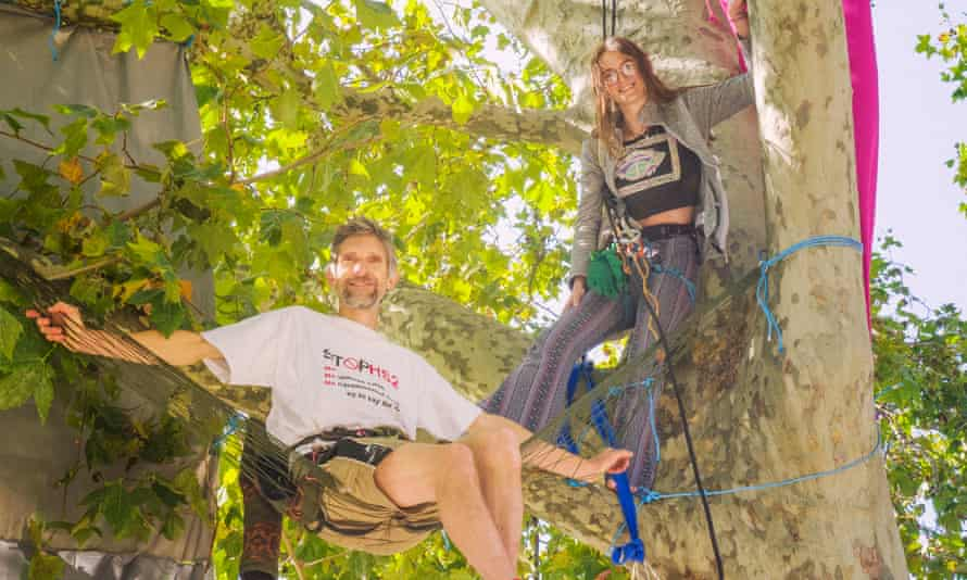 Extinction rebellion protestors , Ellie and Larch, up in the trees [this is their 16th day] in Parlaiment Square.