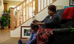 Reba Senior brushes the hair of her granddaughter Lydia at their home in Oregon. Reba adopted her son's daughters in 2015 after they were put in foster care.