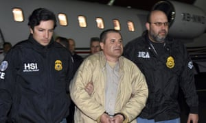 Authorities escort Joaquin 'El Chapo' Guzman from a plane at MacArthur airport in New York state.