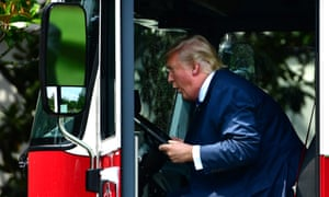 Donald Trump sits in the seat of a fire truck made in Wisconsin during a Made in America product showcase.