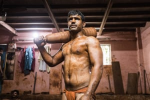 We worship the body': India's kushti mud wrestlers – a photo