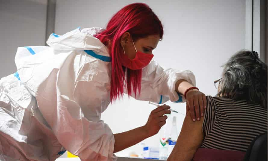 A Serbian medical worker administers a dose of the Oxford-AstraZeneca vaccine in Belgrade.