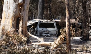 A burnt out car sits on a property after a bushfire swept through the area, in Cooroibah, Queensland, earlier this week.