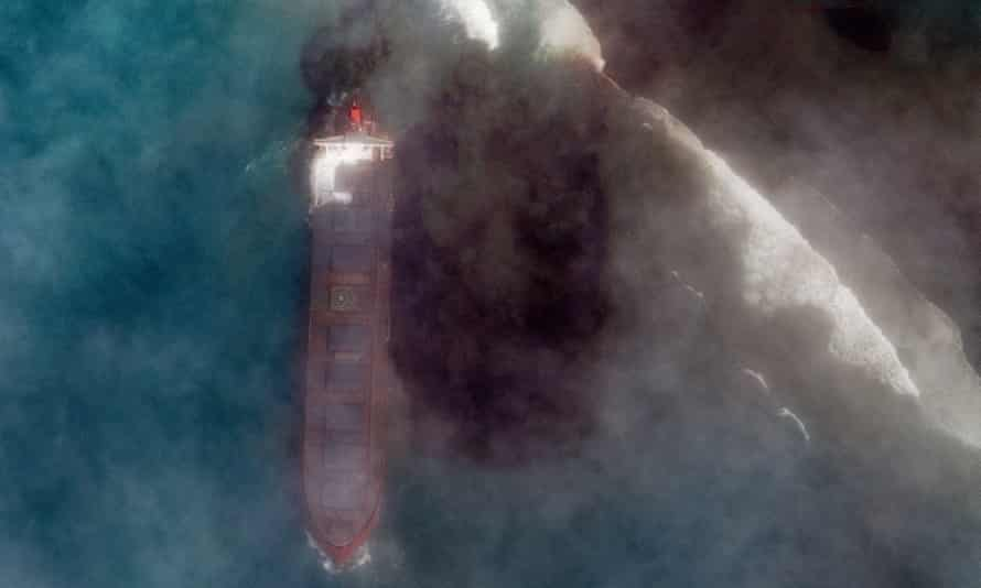 A satellite image of the stranded MV Wakashio, showing the oil spilling from it.