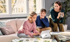 Mother and two children using Microsoft Surface