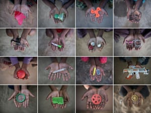 Rohingya children at a refugee camp hold objects they use as toys in Cox's Bazar, Bangladesh