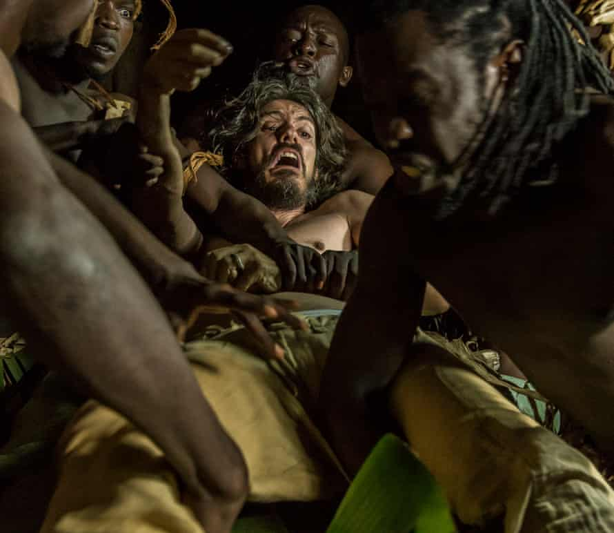 Alan Hofmanis plays the husband of a Ugandan who comes to Uganda to meet his in-laws but ends up being eaten by cannibals because of his nosiness.