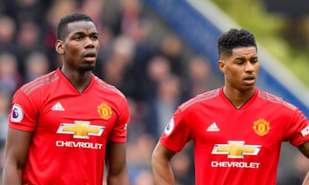 Paul Pogba and Marcus Rashford playing together for Manchester United in 2019.